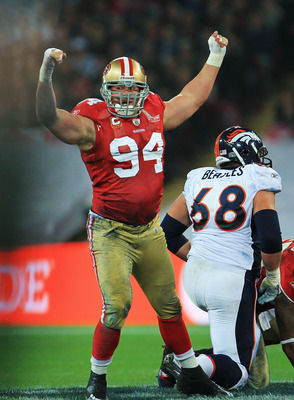 LONDON, ENGLAND - OCTOBER 31:  Justin Smith #94 of San Francisco 49ers celebrates sacking Kyle Orton the Denver Broncos Quarterback during the NFL International Series match between Denver Broncos and San Francisco 49ers at Wembley Stadium on October 31,
