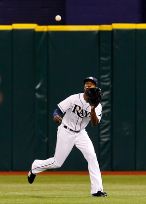 ST. PETERSBURG, FL - MAY 16:  Outfielder B.J. Upton #2 of the Tampa Bay Rays catches a fly ball against the New York Yankees during the game at Tropicana Field on May 16, 2011 in St. Petersburg, Florida.  (Photo by J. Meric/Getty Images)