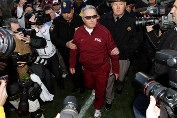 JACKSONVILLE, FL - JANUARY 01:  Head coach Bobby Bowden of the Florida State Seminoles is escorted off the field after defeating the West Virginia Mountaineers during the Konica Minolta Gator Bowl on January 1, 2010 at Jacksonville Municipal Stadium in Ja