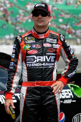 KANSAS CITY, KS - JUNE 04:  Jeff Gordon, driver of the #24 Drive to End Hunger Chevrolet, stands on the grid during qualifying for the NASCAR Sprint Cup Series STP 400 at Kansas Speedway on June 4, 2011 in Kansas City, Kansas.  (Photo by John Harrelson/Ge