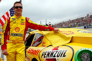 DOVER, DE - MAY 15:  Kurt Busch, driver of the #22 Shell/Pennzoil Dodge, stands next to his car on the grid prior the NASCAR Sprint Cup Series FedEx 400 Benefiting Autism Speaks at Dover International Speedway on May 15, 2011 in Dover, Delaware.  (Photo b