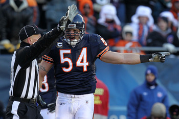 CHICAGO, IL - JANUARY 23:  Brian Urlacher #54 of the Chicago Bears reacts to a penalty called while taking on the Green Bay Packers in the NFC Championship Game at Soldier Field on January 23, 2011 in Chicago, Illinois.  (Photo by Jamie Squire/Getty Image