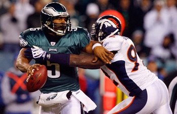 PHILADELPHIA - DECEMBER 27:  Donovan McNabb #5 of the Philadelphia Eagles is pressured by Elvis Dumervil #92 of the Denver Broncos on December 27, 2009 at Lincoln Financial Field in Philadelphia, Pennsylvania. The Eagles defeated the Broncos 30-27.  (Phot