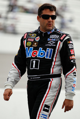 RICHMOND, VA - APRIL 29:  Tony Stewart, driver of the #14 Mobil 1/Office Depot Chevrolet, walks on pit road during qualifying for the NASCAR Sprint Cup Series Crown Royal Presents The Matthew & Daniel Hansen 400 at Richmond International Raceway on April