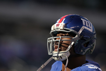 EAST RUTHERFORD, NJ - NOVEMBER 28: Justin Tuck #91 of the New York Giants looks on before the game against the Jacksonville Jaguars during their game on November 28, 2010 at The New Meadowlands Stadium in East Rutherford, New Jersey.  (Photo by Al Bello/G