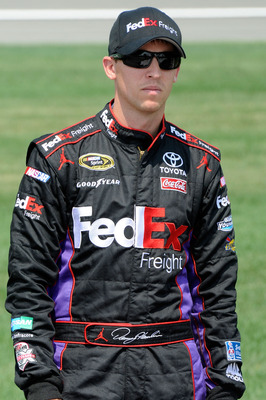KANSAS CITY, KS - JUNE 04:  Denny Hamlin, driver of the #11 FedEx Freight Toyota, stands on the grid during qualifying for the NASCAR Sprint Cup Series STP 400 at Kansas Speedway on June 4, 2011 in Kansas City, Kansas.  (Photo by John Harrelson/Getty Imag