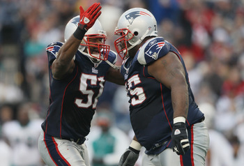 FOXBORO, MA - JANUARY 02:  Jerod Mayo #51 of the New England Patriots congratulates Vince Wilfork #75 in the second half against the Miami Dolphins on January 2, 2011 at Gillette Stadium in Foxboro, Massachusetts.  (Photo by Elsa/Getty Images)