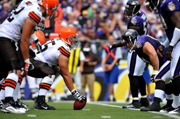 BALTIMORE - SEPTEMBER 27:  Alex Mack #55 of the Cleveland Browns snaps the ball against the Baltimore Ravens at M&T Bank Stadium on September 27, 2009 in Baltimore, Maryland. The Ravens defeated the Browns 34-3. (Photo by Larry French/Getty Images)