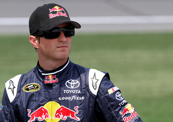 KANSAS CITY, KS - JUNE 04:  Kasey Kahne, driver of the #4 Red Bull Toyota, stands on the grid during qualifying for the NASCAR Sprint Cup Series STP 400 at Kansas Speedway on June 4, 2011 in Kansas City, Kansas.  (Photo by Jerry Markland/Getty Images for