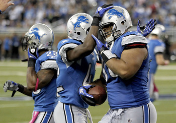 DETROIT - OCTOBER 10: Ndamukong Suh #90 of the Detroit Lions and teammates celebrate a fourth quarter interception against the St. Louis Rams on October 10, 2010 at Ford Field in Detroit, Michigan. Detroit won the game 44-6. (Photo by Gregory Shamus/Getty