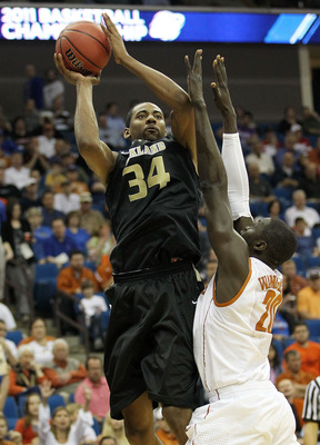TULSA, OK - MARCH 18:  Keith Benson #34 of the Oakland Golden Grizzlies goes up for a shot against Alexis Wangmene #20 of the Texas Longhorns during the second round game of the 2011 NCAA men's basketball tournament at BOK Center on March 18, 2011 in Tuls