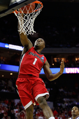 CHARLOTTE, NC - MARCH 18:  Travis Leslie #1 of the Georgia Bulldogs dunks the ball in the first half while taking on the Washington Huskies during the second round of the 2011 NCAA men's basketball tournament at Time Warner Cable Arena on March 18, 2011 i