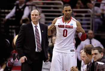 CLEVELAND, OH - MARCH 18: Jared Sullinger #0 of the Ohio State Buckeyes holds his jersey out as head coach Thad Matta looks on late in the game against the Texas-San Antonio Roadrunners during the second round of the 2011 NCAA men's basketball tournament