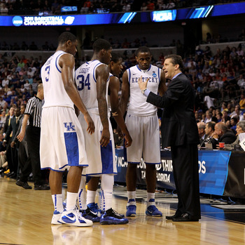 TAMPA, FL - MARCH 19:  head coach John Calipari of the Kentucky Wildcats talks with Terrence Jones #3, DeAndre Liggins #34, Brandon Knight #12 and Darius Miller #1 against the West Virginia Mountaineers during the third round of the 2011 NCAA men's basket