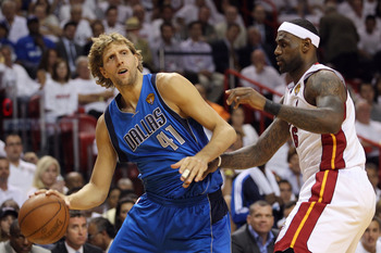 MIAMI, FL - JUNE 02:  Dirk Nowitzki #41 of the Dallas Mavericks drives on LeBron James #6 of the Miami Heat in the first quarter in Game Two of the 2011 NBA Finals at American Airlines Arena on June 2, 2011 in Miami, Florida. NOTE TO USER: User expressly
