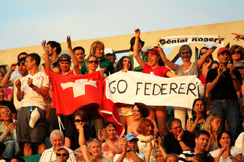 PARIS, FRANCE - JUNE 03:  Roger Federer fans cheer on their player during the men's singles semi final match between Roger Federer of Switzerland and Novak Djokovic of Serbia on day thirteen of the French Open at Roland Garros on June 3, 2011 in Paris, Fr