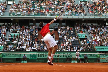 PARIS, FRANCE - JUNE 03:  Roger Federer of Switzerland serves during the men's singles semi final match between Roger Federer of Switzerland and Novak Djokovic of Serbia on day thirteen of the French Open at Roland Garros on June 3, 2011 in Paris, France.