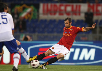 ROME, ITALY - MAY 22:  Mirko Vucinic of AS Roma scores the second goal for his team during the Serie A match between AS Roma and UC Sampdoria at Stadio Olimpico on May 22, 2011 in Rome, Italy.  (Photo by Paolo Bruno/Getty Images)