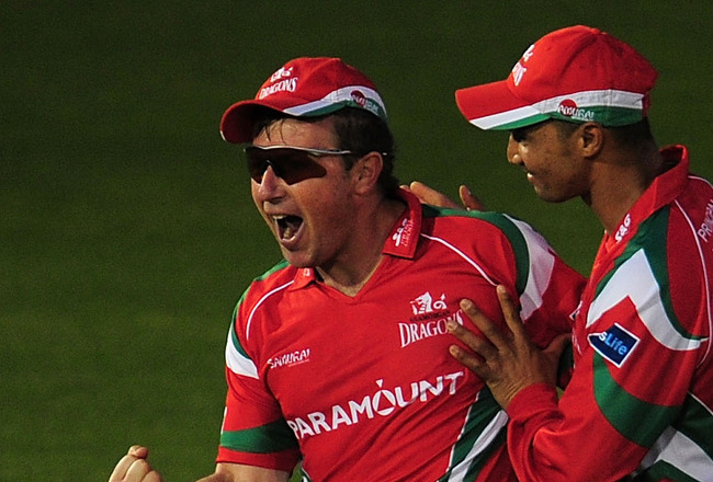 CARDIFF, WALES - JUNE 03:  Glamorgan fielder Robert Croft (l) celebrates with Alviro Petersen after taking a great catch to dismiss Scott Newman during the Friends Life T20 match between Glamorgan and Middlesex at the Swalec Stadium on June 3, 2011 in Car