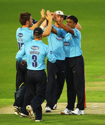 NOTTINGHAM, ENGLAND - JULY 26:  Yasir Arafat of Sussex is congratulated on bowling Alex Hales of Nottinghamshire during the Friends Provident T20 Quarter Final match between Nottinghamshire and Sussex at Trent Bridge on July 26, 2010 in Nottingham, Englan