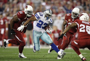 GLENDALE, AZ - DECEMBER 25:  Runningback Tashard Choice #23 of the Dallas Cowboys rushes the football past Gabe Watson #98 of the Arizona Cardinals during the NFL game at the University of Phoenix Stadium on December 25, 2010 in Glendale, Arizona. The Car
