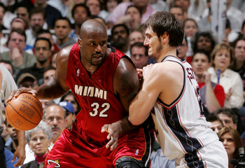 EAST RUTHERFORD - APRIL 28:  Shaquille O'Neal #32 of the Miami Heat moves the ball against Nenad Krstic #12 of the New Jersey Nets in Game three of the Eastern Conference Quarterfinals during the 2005 NBA Playoffs April 28, 2005 at Continental Airline Are