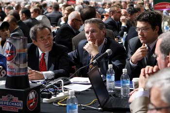 MONTREAL , QC - JUNE 27:  General Manager Garth Snow of the New York Islanders (C) and assistant General Manager Ryan Jankowski (R) sit at the draft table during the second day of the 2009 NHL Entry Draft at the Bell Centre on June 27, 2009 in Montreal, Q