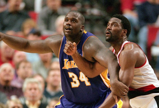 31 Oct 2000: Shaquille O''Neal #34 of the Los Angeles Lakers guards Dale Davis #34 of the Portland Trail Blazers at the Rose Garden in Portland, Oregon. The Lakers defeated the Blazers 96-86. NOTE TO USER: It is expressly understood that the only rights A
