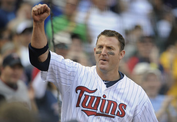 MINNEAPOLIS, MN - APRIL 10: Designated hitter Jim Thome #25 of the Minnesota Twins comes out for a curtain call following a two-run homer off Jerry Blevins #13 of the Oakland Athletics during the eighth inning of their game on April 10, 2011 at Target Fie
