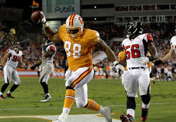 TAMPA, FL - DECEMBER 05:  Tight end John Gilmore #88 of the Tampa Bay Buccaneers catches a touchdown pass against the Atlanta Falcons during the game at Raymond James Stadium on December 5, 2010 in Tampa, Florida.  (Photo by J. Meric/Getty Images)