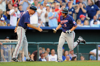 KANSAS CITY, MO - JUNE 3: Michael Cuddyer #5 of the Minnesota Twins is greeted by third base coach Steve Liddle #9 after hitting a solo home run against the Kansas City Royals in the third inning at Kauffman Stadium on June 3, 2011 in Kansas City, Missour