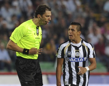 UDINE, ITALY - MAY 22:   Referee Paolo Tagliavento (L) talks with Alexis Samnchez of Udinese during the Serie A match between Udinese Calcio and AC Milan  at Stadio Friuli on May 22, 2011 in Udine, Italy.  (Photo by Dino Panato/Getty Images)