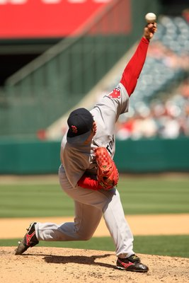 ANAHEIM, CA - MAY 14:  Pitcher Hideki Okajima #37 of the Boston Red Sox throws a pitch against the Los Angeles Angels of Anaheim on May 14, 2009 at Angel Stadium in Anaheim, California.   The Angels won 5-4 in 12 innings.  (Photo by Stephen Dunn/Getty Ima