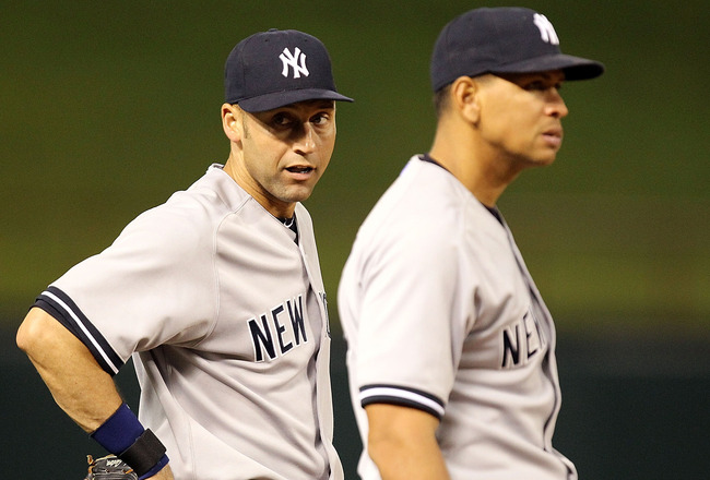 ARLINGTON, TX - MAY 07:  Derek Jeter #2 and Alex Rodriguez #13 of the New York Yankees talk between innings at Rangers Ballpark in Arlington on May 7, 2011 in Arlington, Texas.  (Photo by Ronald Martinez/Getty Images)