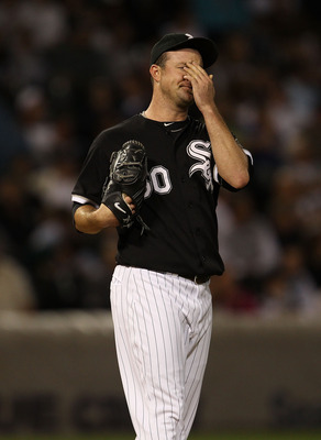 CHICAGO - SEPTEMBER 14: Starting pitcher John Danks #50 of the Chicago White Sox reacts after giving up a run to the Minnesota Twins at U.S. Cellular Field on September 14, 2010 in Chicago, Illinois. (Photo by Jonathan Daniel/Getty Images)