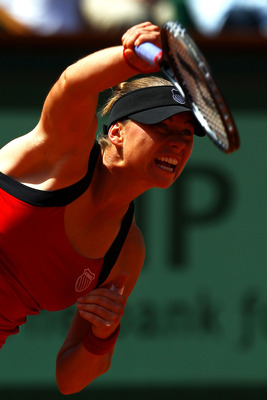 PARIS, FRANCE - MAY 29:  Vera Zvonareva of Russia serves during the women's singles round four match between Vera Zvonareva of Russia and Anastasia Pavlyuchenkova of Russia on day eight of the French Open at Roland Garros on May 29, 2011 in Paris, France.