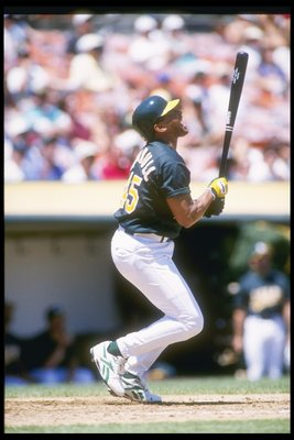 2 Aug 1995:  Outfielder Danny Tartabull of the Oakland Athletics looks up after hitting the ball during a game against the Texas Rangers at the Oakland Coliseum in Oakland, California.  The Rangers won the game 5-4. Mandatory Credit: Otto Greule  /Allspor