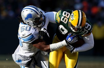 GREEN BAY, WI - DECEMBER 28: Ernie Sims #50 of the Detroit Lions brings down James Jones #89 of the Green Bay Packers on December 28, 2008 at Lambeau Field in Green Bay, Wisconsin. The Packers defeated the Lions 31-21. (Photo by Jonathan Daniel/Getty Imag