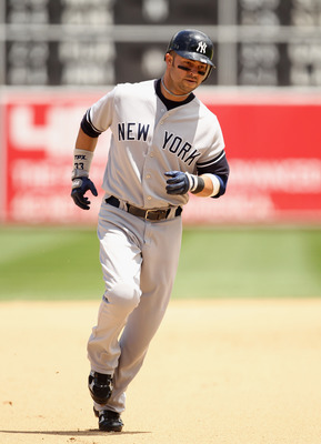 OAKLAND, CA - JUNE 01:  Nick Swisher #33 of the New York Yankees rounds the bases after he hit a three run home run in the fourth inning against the Oakland Athletics at Oakland-Alameda County Coliseum on June 1, 2011 in Oakland, California.  (Photo by Ez