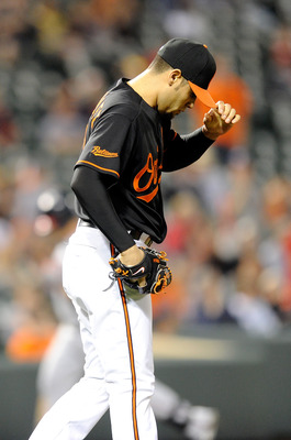 BALTIMORE, MD - MAY 20:  Michael Gonzalez #51 of the Baltimore Orioles reacts after giving up a home run in the eighth inning against the Washington Nationals at Oriole Park at Camden Yards on May 20, 2011 in Baltimore, Maryland.  (Photo by Greg Fiume/Get
