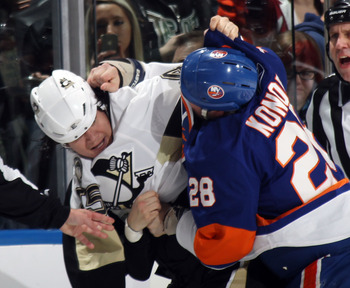 UNIONDALE, NY - APRIL 08:  Arron Asham #45 of the Pittsburgh Penguins fights with Zenon Konopka #28 of the New York Islanders in the first period at the Nassau Coliseum on April 8, 2011 in Uniondale, New York.  (Photo by Bruce Bennett/Getty Images)