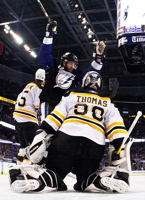 TAMPA, FL - MAY 25:  Simon Gagne #12 of the Tampa Bay Lightning celebrates a goal by Teddy Purcell #16 as Tim Thomas #30 of the Boston Bruins defends in Game Six of the Eastern Conference Finals during the 2011 NHL Stanley Cup Playoffs at St Pete Times Fo