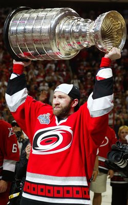 RALEIGH, NC - JUNE 19: Erik Cole #26 of the Carolina Hurricanes celebrates with the Stanley Cup after defeating the Edmonton Oilers in game seven of the 2006 NHL Stanley Cup Finals on June 19, 2006 at the RBC Center in Raleigh, North Carolina. The Hurrica