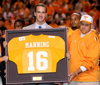 KNOXVILLE, TN - OCTOBER 29:  Former Tennesse quarterback Peyton Manning and current quarterback for the Indianapolis Colts is honored alongside his former college coach Phillip Fulmer before the start of the game against the South Carolina Gamecocks on Oc