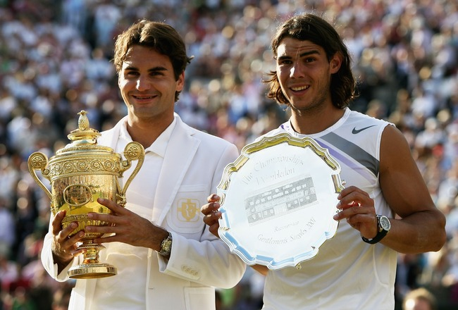 LONDON - JULY 08:  Roger Federer of Switzerland poses with the winners trophy alongside runner-up Rafael Nadal of Spain following the Men's Singles final match during day thirteen of the Wimbledon Lawn Tennis Championships at the All England Lawn Tennis a