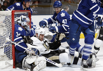 TORONTO, CANADA - FEBRUARY 26: Darryl Boyce #47 of the Toronto Maple Leafs pushes Mike Rupp #17 of the Pittsburgh Penguins into James Reimer #34 of the Toronto Maple Leafs during game action at the Air Canada Centre February 26, 2011 in Toronto, Ontario,