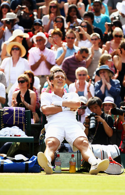 LONDON, ENGLAND - JUNE 30:  Tomas Berdych of Czech Republic celebrates winning his Quarter Final match against Roger Federer of Switzerland on Day Nine of the Wimbledon Lawn Tennis Championships at the All England Lawn Tennis and Croquet Club on June 30,