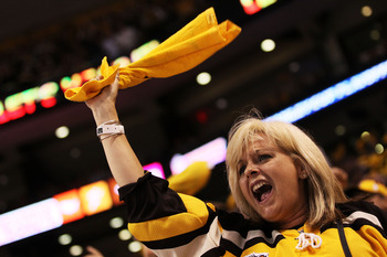 BOSTON, MA - MAY 27:  A Boston Bruins fan cheers during Game Seven of the Eastern Conference Finals against the Tampa Bay Lightning during the 2011 NHL Stanley Cup Playoffs at TD Garden on May 27, 2011 in Boston, Massachusetts.  (Photo by Elsa/Getty Image