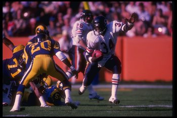 11 Nov 1984:  Running back Walter Payton of the Chicago Bears (right) runs the ball during a game against the Los Angeles Rams at Anaheim Stadium in Anaheim, California.  The Rams won the game, 29-13. Mandatory Credit: Rick Stewart  /Allsport
