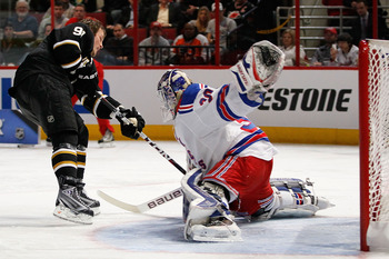 RALEIGH, NC - JANUARY 29:  Brad Richards #91 of the Dallas Stars shoots on Henrik Lundqvist #30 of New York Rangers in the elimination shootout during the Honda NHL SuperSkills competition part of 2011 NHL All-Star Weekend at the RBC Center on January 29,